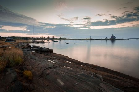 Early morning on White Sea. Landscape with traditional north church on island in Kem, Republic of Karelia, Russia photo