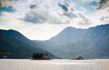 Bay of Kotor and The island of St. George opposite the town of Perast photo