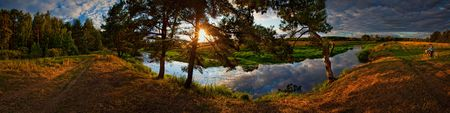 Summer panorama with river and pine-tree on sunset Stock Photo - 7675016