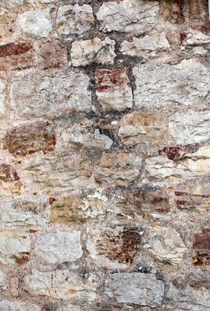deliverance: Detail of stone wall of medieval city