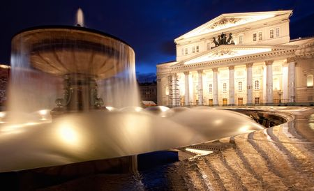 The Bolshoi Theatre (Great Theater) in Moscow by Joseph Bove. Photo did through fountain at night