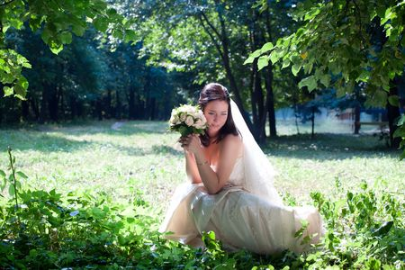 Bride portrait in a forest photo