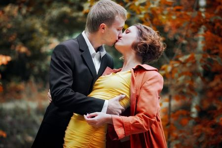 Young couple on date in an autumn park photo