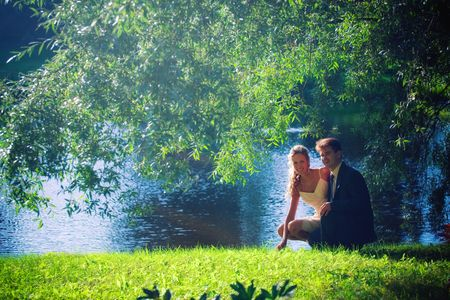 Portrait of newlyweds under a willow