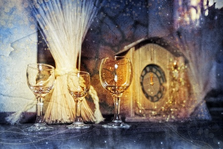 Wine glasses and clock at midnight photo