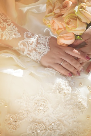Newlyweds hands with wedding rings. photo