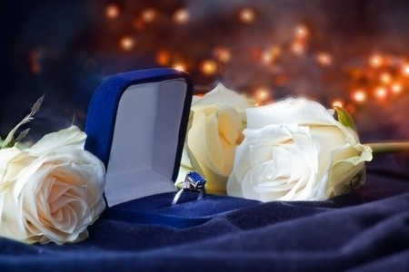 Box with diamond ring in roses photo