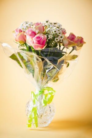 Bouquet of blossom pink roses and chrysanths photo