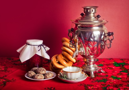 bagels: Traditional Russian tea from Samovar with cakes, bagels and raspberry jam