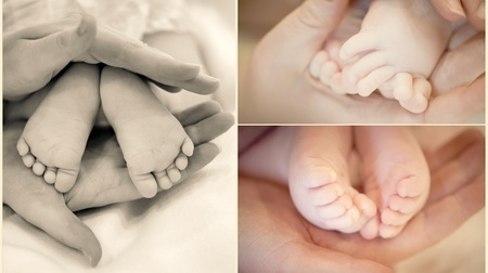 Collection of babys legs in mothers hands in soft focus photo