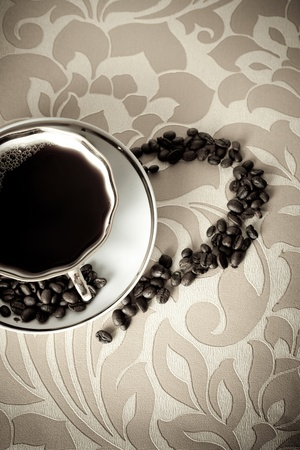 A cup of coffee with beans photo