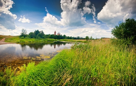 Summer panoramic landscape with river and church photo