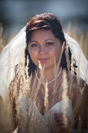 Beautiful bride posing in autumn field photo