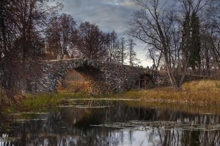bridge in nature: Autumn landscape with arched boulder bridge