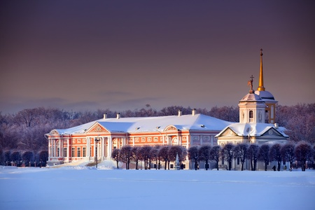 Winter landscape with Moscow estate Kuskovo at sunny evening