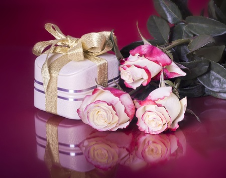 The present with gift box and roses photo