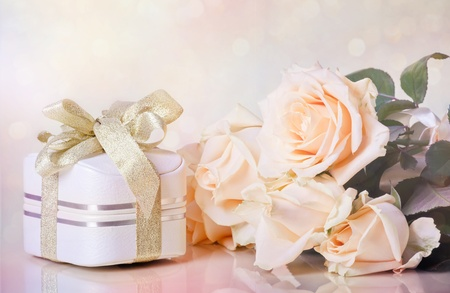 Peach roses with gift box on soft background with bokeh in watercolor look Stock Photo - 11473269
