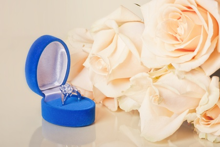 propose: Peach rose with topaz ring in a box on soft background with bokeh in watercolor look Stock Photo