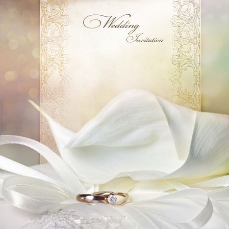 Wedding invitation card with calla lilies and golden rings photo