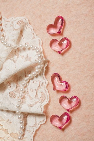 Wedding background with hearts,  lace and pearl beads