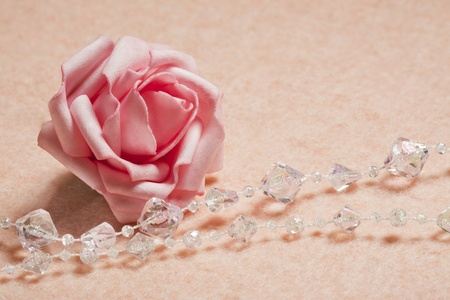 Wedding background with rose and  beads photo