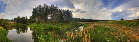 Summer panoramic landscape with a river at windy day photo