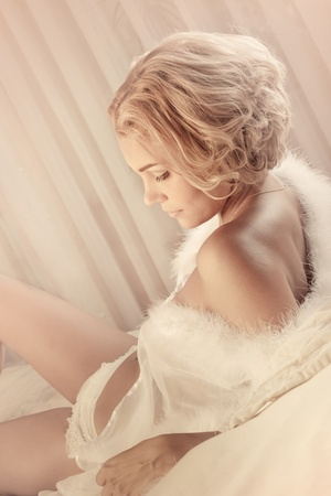 Young sexy beautiful woman in soft morning light