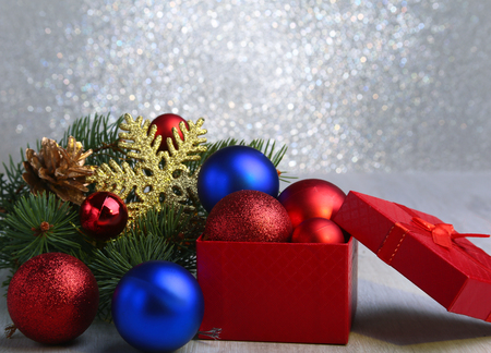 Christmas gifts. Christmas decoration with presents and red ball with fir branches Stock Photo