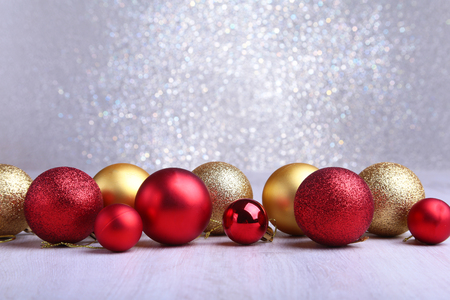 Christmas red and gold balls isolated on silver background