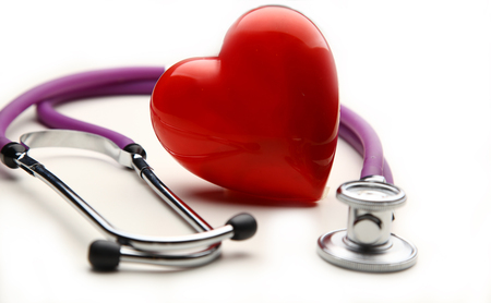 Heart with a medical stethoscope, isolated on white background Foto de archivo