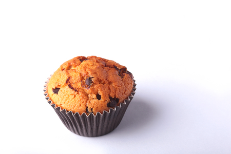 Tasty chocolate cupcake, muffin on a white wooden table. Stock Photo