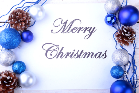 Text merry christmas on paper with many balls