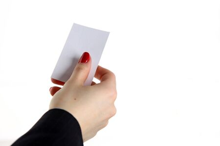 Female hand holding business card in office