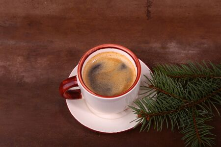Good morning or Have a nice day Merry Christmas .Cup of coffee with cookies and fresh fir or pine branch