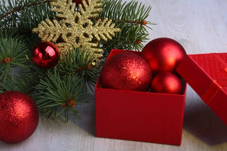Christmas gifts. Christmas decoration with presents and red ball with fir branches 版權商用圖片