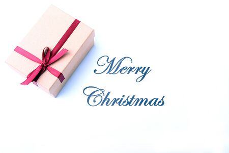 Text merry christmas on paper with gift box 版權商用圖片