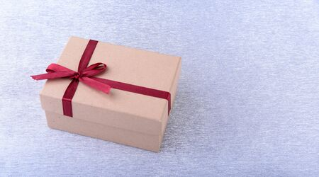 Gift boxes with bow on wood background. Christmas Decoration.