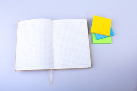 Open White notepad with colorful sticky reminder notes