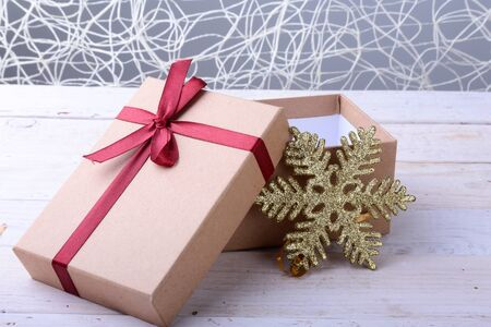 Open Gift boxes with bow on wood background. Christmas Decoration.