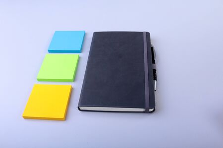 Top view of blank notebook and empty note sticker on a blue background. Back to school concept. Flat lay. 版權商用圖片