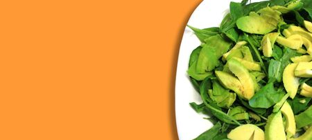Raw vegan food. Salad of greens, fresh vegetables, avocado arugula spinach, close-up. 스톡 콘텐츠