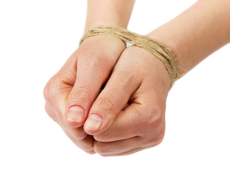 tied girl: woman hands bound by rope or string isolated on white background Stock Photo