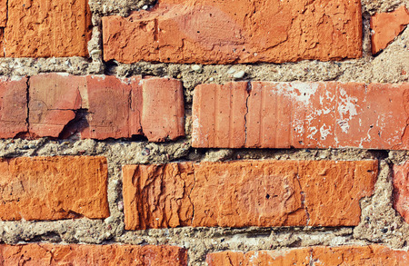 old red brick wall with cracks and scuffs, style loft background, vintage toning