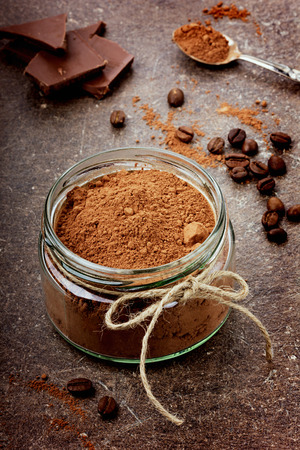 chocolate powder: Cocoa in a glass cup with dark chocolate Stock Photo