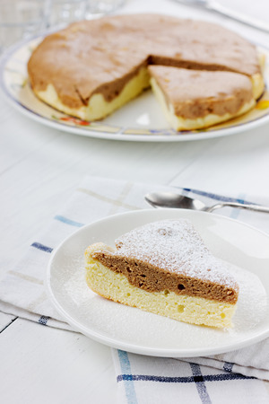 icing sugar: Pie with icing sugar on a white plate Stock Photo