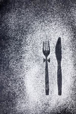 imprint: Knife and fork imprint in powdered sugar