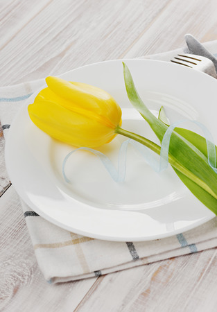 Spring table settings with fresh tulips photo