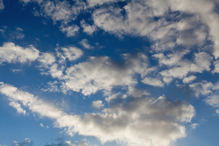 rainclouds: blue sky with fluffy clouds cover Stock Photo