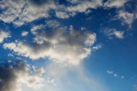rainclouds: blue sky with white fluffy clouds