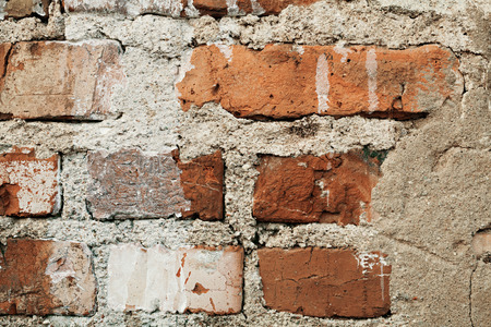 scuff: old red brick wall with cracks and scuffs, style loft background Stock Photo